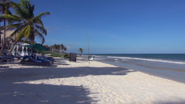beautiful and relaxing beach at tulum mexico - tourist resort stock videos & royalty-free footage