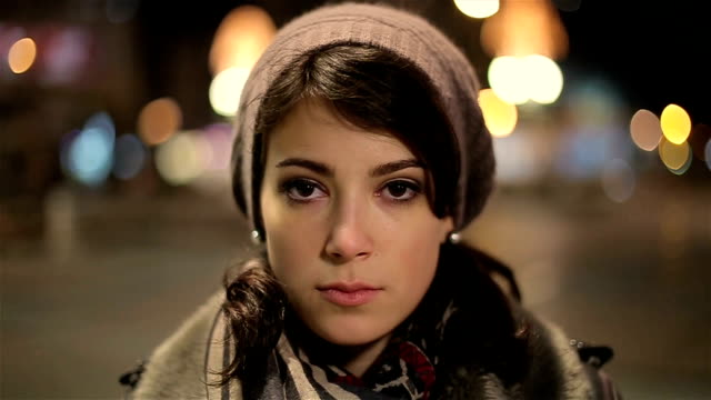 beautiful and sad young woman looking at camera - tristezza video stock e b–roll