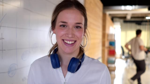 Beautiful and successful young girl in a coworking space