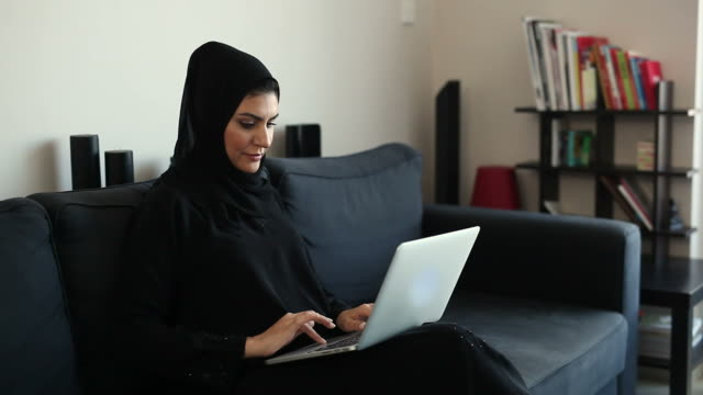 beautiful arab woman surfing the net at home - middle eastern ethnicity stock videos & royalty-free footage