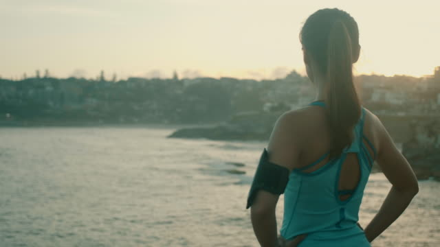 Beautiful Asian Athlete looking over the sea (slow motion)