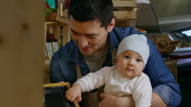 beautiful asian family posing with baby at farm store - milk bottle stock videos & royalty-free footage