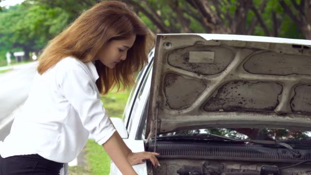Beautiful Asian Girl Look At The Engine Her Car Broke Down