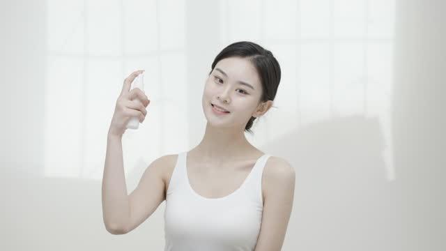 beautiful asian girl, skin care - spraying stock videos & royalty-free footage