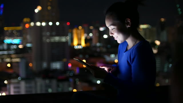 beautiful asian girl using smart phone top of a building - cityscape stock videos & royalty-free footage