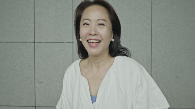 beautiful asian mature woman smiling - mature adult stock videos & royalty-free footage