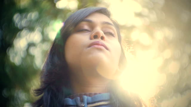 beautiful asian serene young woman enjoy fresh air in nature. - inquadratura estrema dal basso video stock e b–roll