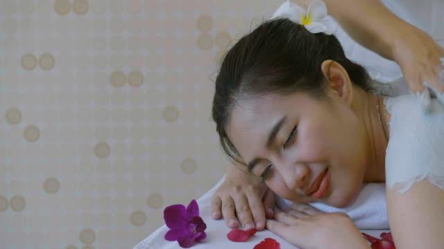 ds : beautiful asian woman enjoying skin rejuvenation treatment with body mask - exfoliation stock videos & royalty-free footage