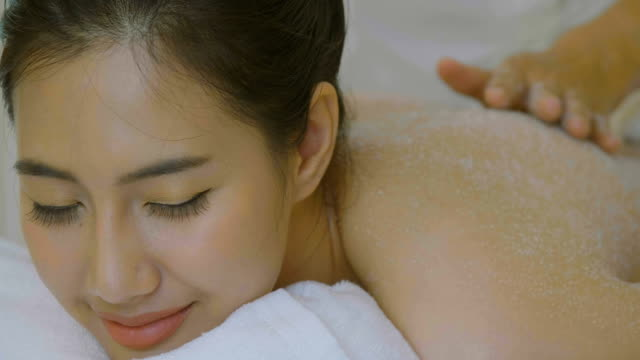 beautiful asian woman having exfoliation treatment in spa - exfoliation stock videos & royalty-free footage