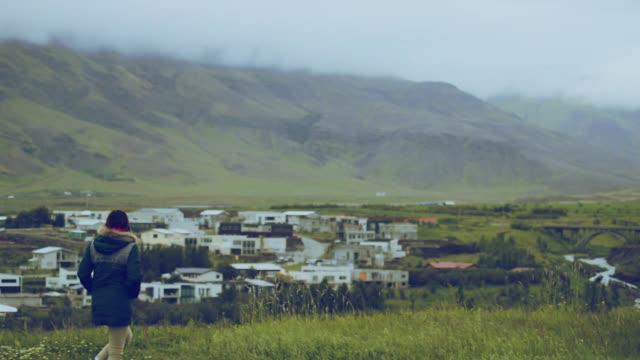 beautiful asian woman travel in the morning at mosfellsbær city in iceland, slow motion - business travel stock videos and b-roll footage