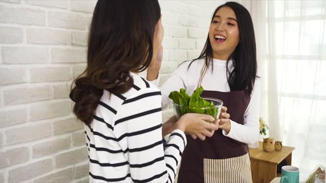 beautiful asian women are choosing vegan food.healthy, diet, healthcare fruits or food - orange stock videos & royalty-free footage