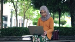 Beautiful asian women using laptop outdoor