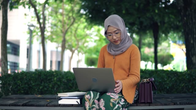 beautiful asian women using laptop outdoor - 20 24 years stock videos & royalty-free footage