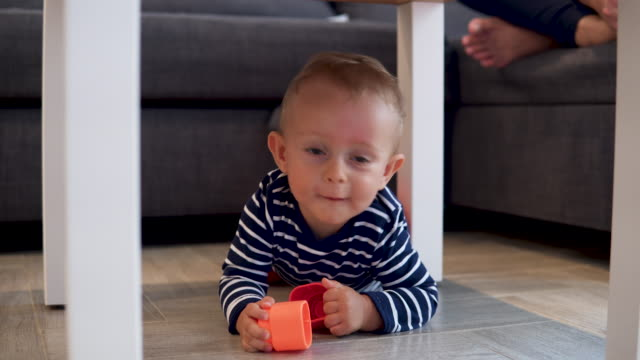 beautiful baby boy under the table - hiding stock videos & royalty-free footage