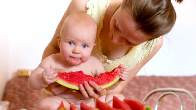 beautiful baby eating watermelon