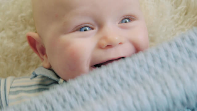 beautiful baby giggles and smiles - soft blanket stock videos and b-roll footage