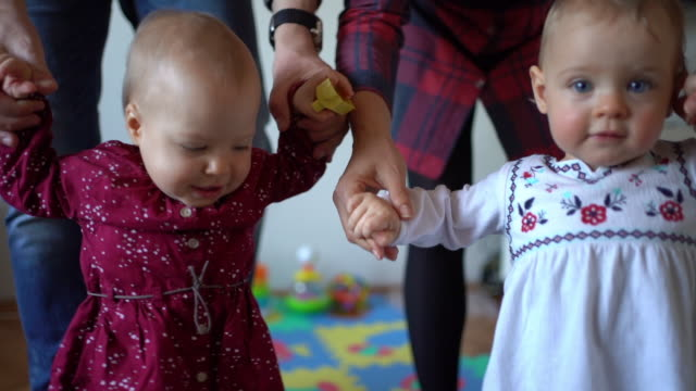 beautiful baby twins learn to walk - baby girls stock videos & royalty-free footage