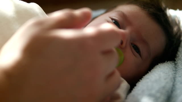 beautiful baby with pacifier - pacifier stock videos and b-roll footage