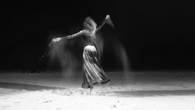 beautiful ballerina dancing in a pirouette with powder snow at studio. slow motion - powder snow stock videos and b-roll footage