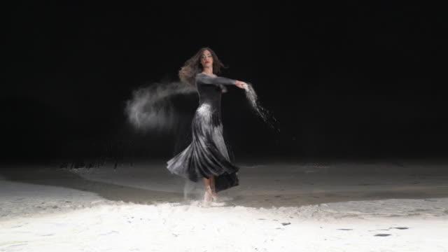 beautiful ballerina dancing in a pirouette with powder snow at studio. slow motion - ballet shoe stock videos and b-roll footage