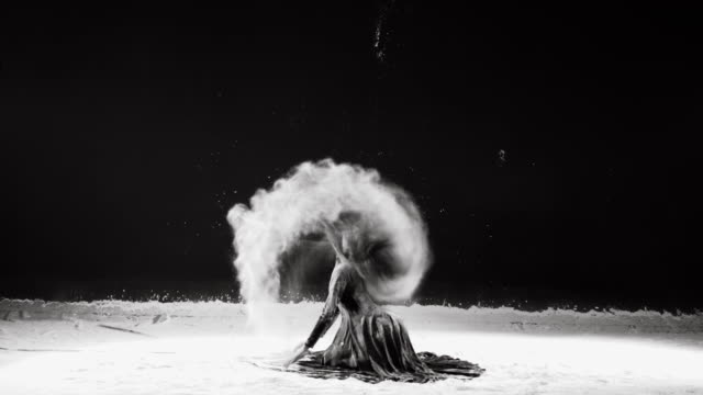 Beautiful ballerina dancing in powder snow