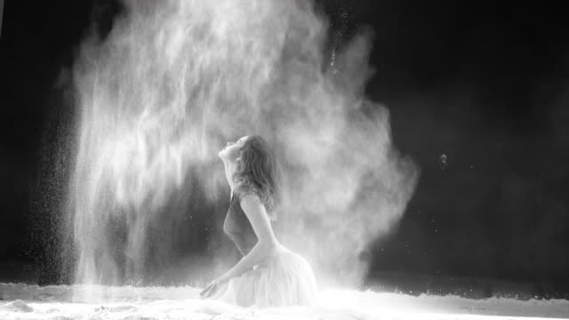 beautiful ballerina dancing in powder snow - flour stock videos & royalty-free footage