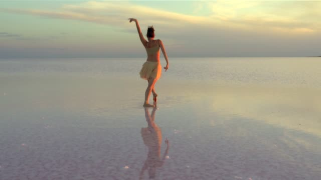 beautiful ballerina dancing on the lake with red tulles - ballet dancer stock videos & royalty-free footage