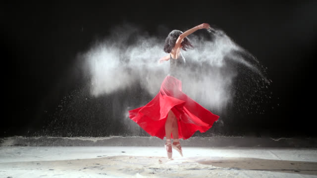 beautiful ballerina dancing with powder snow at studio. - ballet dancer stock videos & royalty-free footage