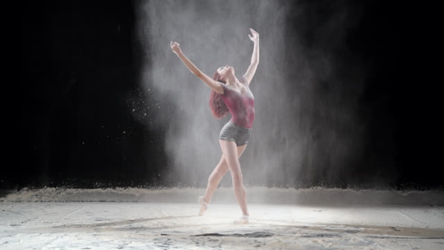 beautiful ballerina dancing with powder snow at studio. - powder snow stock videos and b-roll footage