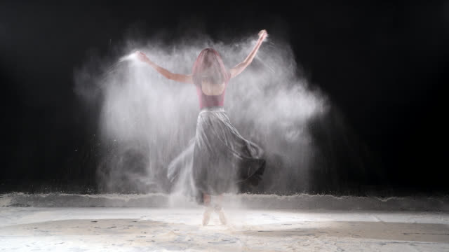 beautiful ballerina dancing with powder snow at studio. - ballet shoe stock videos and b-roll footage