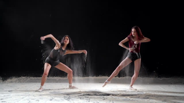 beautiful ballerinas dancing with powder snow at studio. slow motion - bobsleighing stock videos & royalty-free footage
