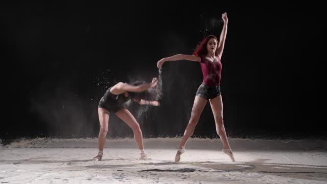 beautiful ballerinas dancing with powder snow at studio. slow motion - ballet dancer stock videos & royalty-free footage