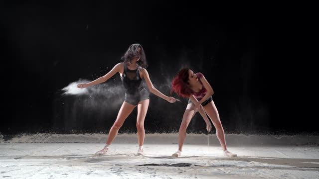 beautiful ballerinas dancing with powder snow at studio. - ballet shoe stock videos and b-roll footage