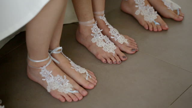 beautiful barefoot sandals for bride in beach wedding. - sandal stock videos and b-roll footage