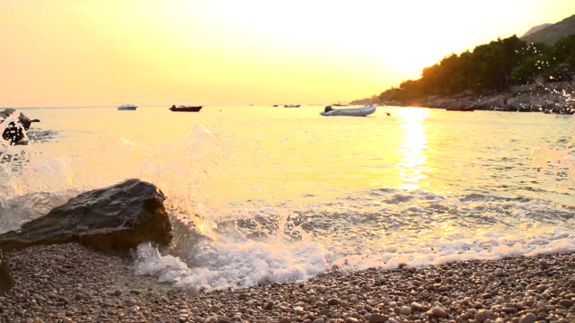 hd super slow mo: beautiful bay at sunset - anchored stock videos & royalty-free footage