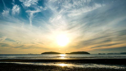 beautiful beach with island background at sunrise, time lapse - dramatic sky stock videos & royalty-free footage