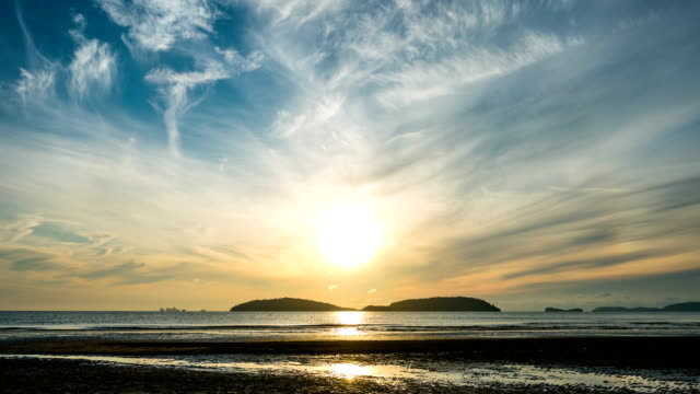 beautiful beach with island background at sunrise, time lapse video - majestic stock videos & royalty-free footage