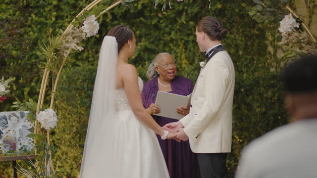 beautiful birde and groom hold hands at the altar - eternity stock videos & royalty-free footage