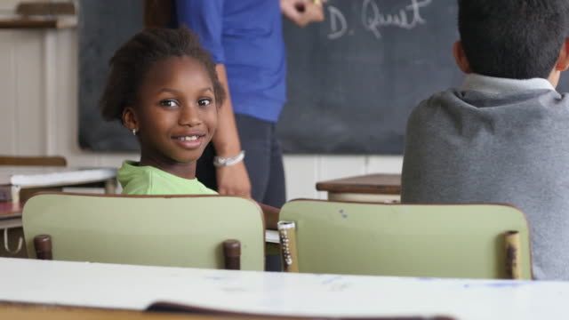 beautiful black little girl facing camera smiling during class at a rural school - south america stock videos & royalty-free footage