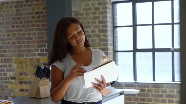 beautiful black woman at home checking her mail smiling - letterbox stock videos & royalty-free footage