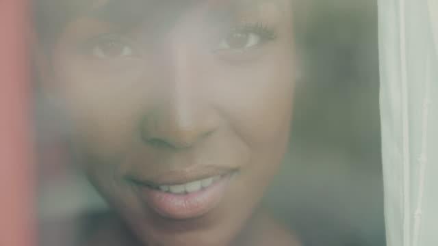 beautiful black woman behind window glass - video portrait stock videos & royalty-free footage