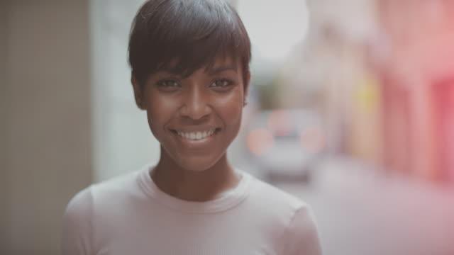 Beautiful black woman slowmotion video portrait