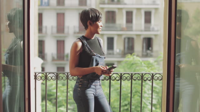 beautiful black woman slowmotion video portrait - building terrace stock videos and b-roll footage