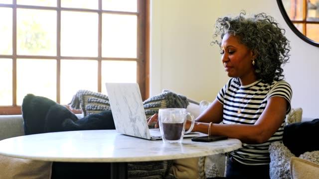 Beautiful Black Woman Using Laptop at Home