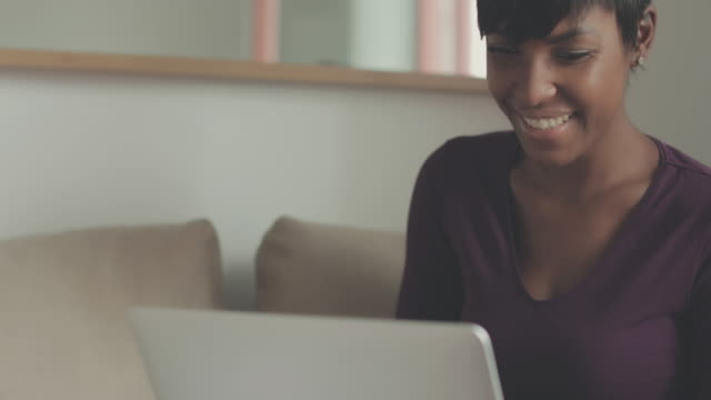 Beautiful black woman working at home