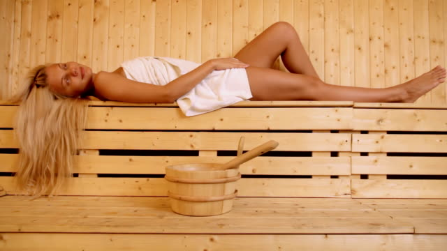 beautiful blond woman in sauna - sauna stock videos and b-roll footage