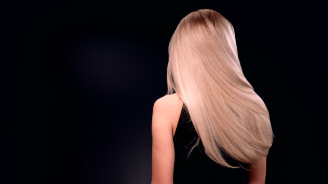beautiful blond woman tossing her long hair - long hair stock videos & royalty-free footage