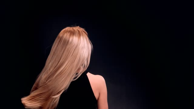 beautiful blond woman tossing her long, straight hair - long stock videos & royalty-free footage