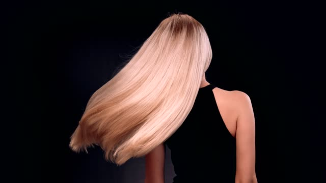 beautiful blond woman tossing her long, straight hair - hair treatment stock videos and b-roll footage