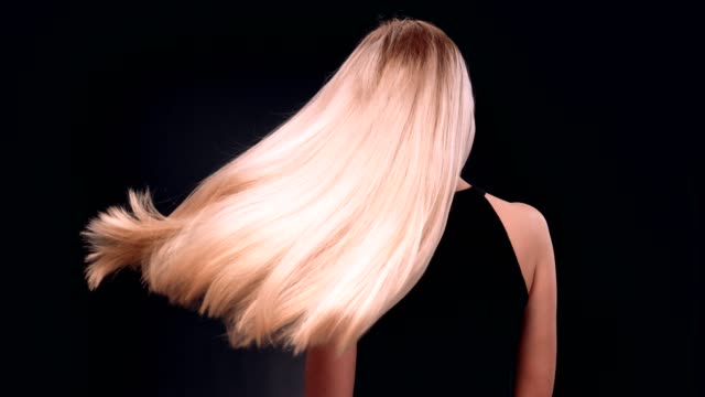 beautiful blond woman tossing her long, straight hair - blonde hair stock videos & royalty-free footage